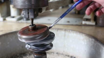 Mechanical polishing of optic lens with a high-tech equipment