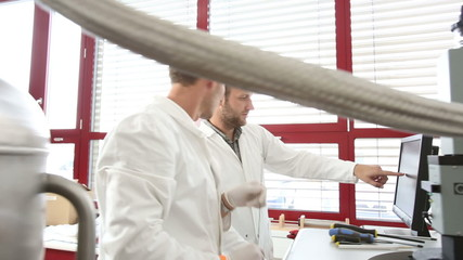 Team of scientists doing research in a high-tech physics lab