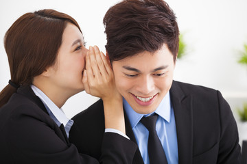 business gossip between businesswoman and businessman