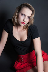 Red skirt and black blouse in studio