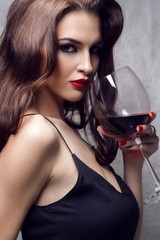 Beautiful young woman with wine glass