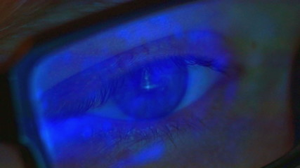 The man look through glasses at monitor