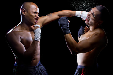 sparring mma fighters or boxers punching each other