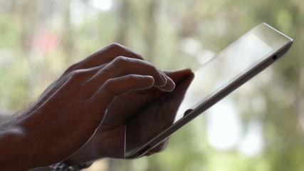 Man Using Digital Tablet in the park