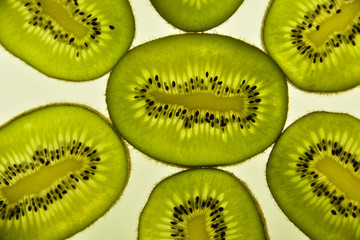 Kiwi fruit, sliced and cut in round pieces, nice background