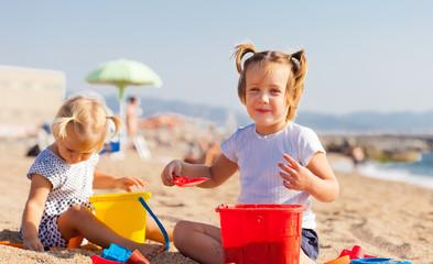 Two little children  on beach