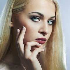 Blond woman.Beautiful girl model with blue eyes lens