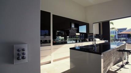 Contemporary modern kitchen in waterfront luxury home
