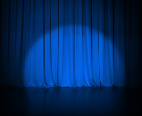 theatre dark blue curtain or drapes with light spot