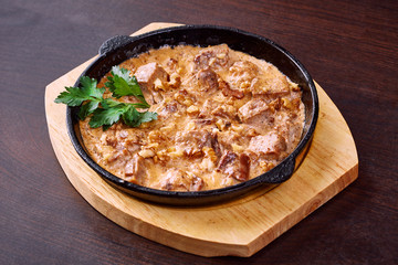 Appetizing meat baked with cheese and walnuts