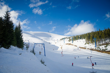 Ski lift and ski course in the mountains