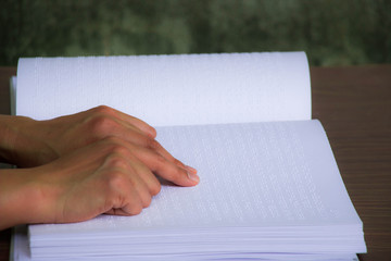 Male Hand Reading Braille