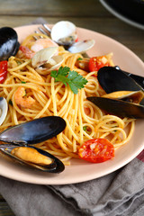 Pasta with mussels and squid in a plate