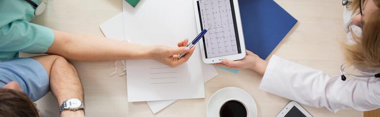 Medical team analyzing cardiogram