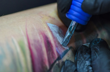 tattoo artist and tattoo