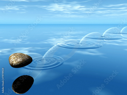 Leinwanddruck Bild ricochets of a stone on water .