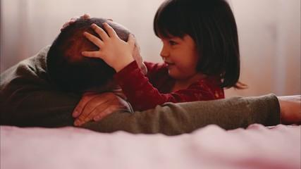 Little Girl is Hugging her Dad