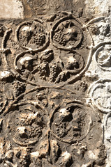 Detail of carved stone with grape