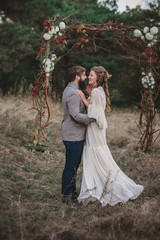 Groom and bride in the wood
