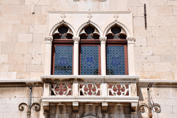 Venetian windows and balcony