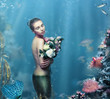 Inspiration. Fantastic Woman with Flowers in Water