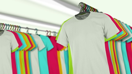 A row of colorful t-shirts hanging on a rack