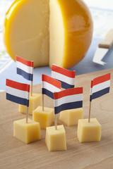 Yellow Edam cheese blocks with Dutch flags
