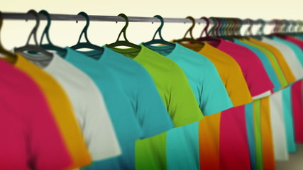 A row of colorful t-shirts