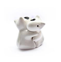 Hugging ceramic dolls.