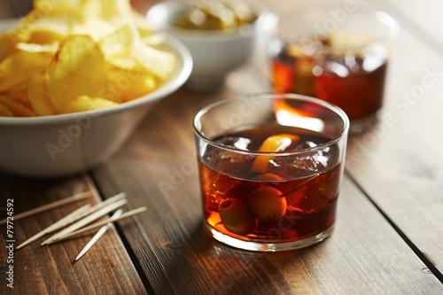 Foto op Plexiglas Buffet, Bar Vermouth glass with appetizers