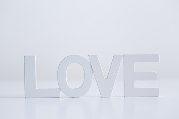 Love word written in white letters