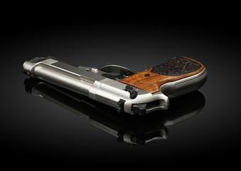 Chromed handgun on black background