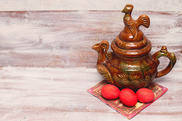 Easter red eggs and soup tureen