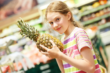 girl shopping at supermarket