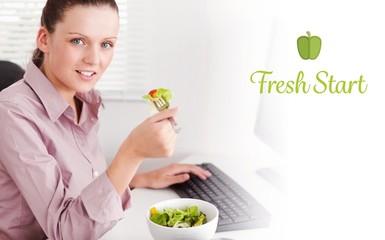Fresh start against businesswoman in office eating salad