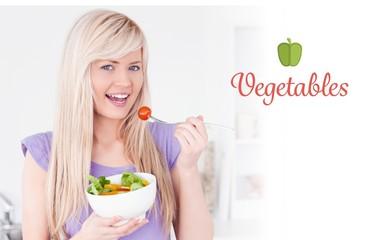 Vegetables against gorgeous smiling female eating her salad