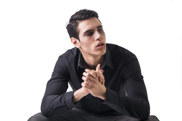 Portrait of a Young Vampire Man with Black Shirt Sitting on