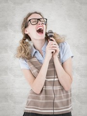 Geeky hipster woman singing into a microphone