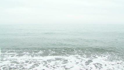 Beautiful Woman In White Dress Walking Along Beach In Waves
