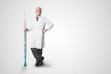 a doctor with huge syringe in hand