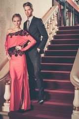 Beautiful well-dressed young couple in luxury interior