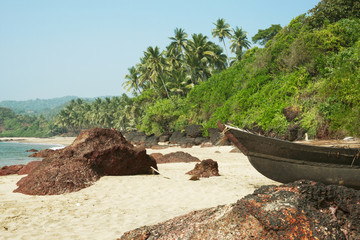Small row boats laying on a beach