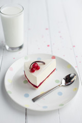 White cheesecake with red berries on a wooden table. Still life