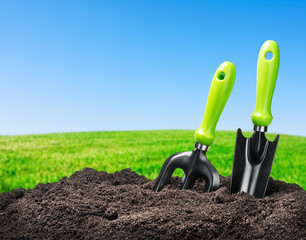 tools garden soil on nature background
