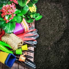 various garden tools in soil