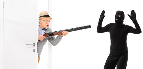 Senior with rifle catching a burglar