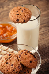 Homemade chocolate and nut cookies with chocolate with a glass o