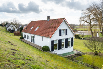 Old houses at the bottom of a Dutch dike