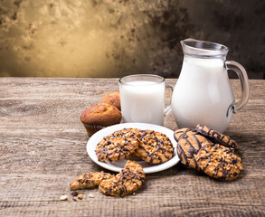 Breakfast with milk and cookies on wooden table