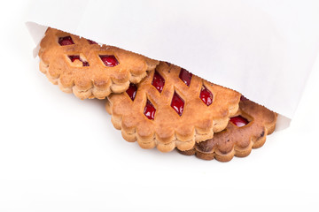 Three biscuits with jam isolated on a white background